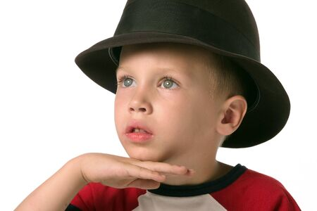 a boy with hat is posing photo