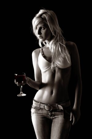 woman drinking wine: Blond woman holding a glass of wine
