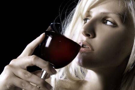 Blond woman drinking wine photo