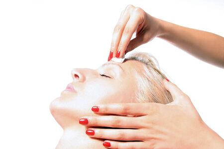 girl is enjoying in face treatment Stock Photo