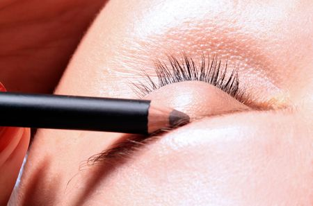 girl is having make up with eye brow pencil Stock Photo