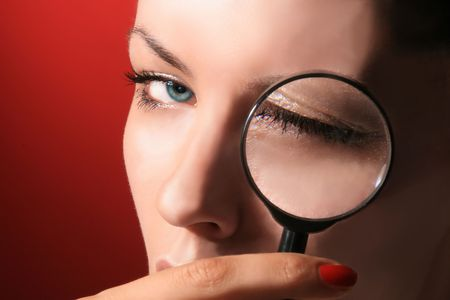 portrait of beauty cosmetic girl with magnifier