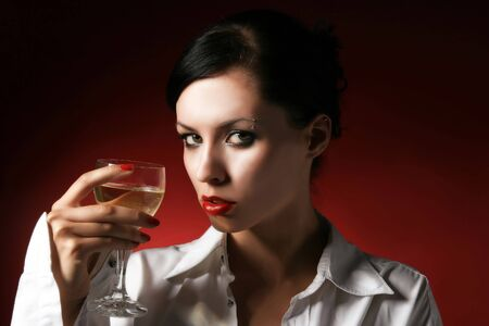 provocation: Woman drinking wine alone, looking at camera