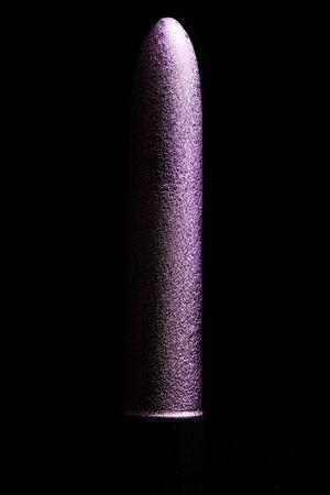 purple metallic vibrator on the black background