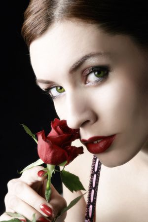 sensual woman with red rose is enjoying