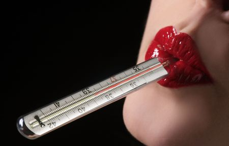 female sexuality: a red woman lips with thermometer inside