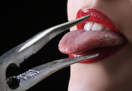 pull out: metal pincers with red lips are pulling tounge  Stock Photo