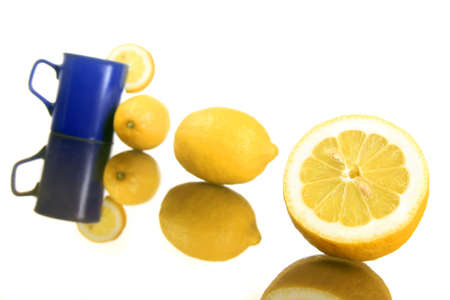 diagonal shot of a lemons and blue mug Stock Photo - 2737327