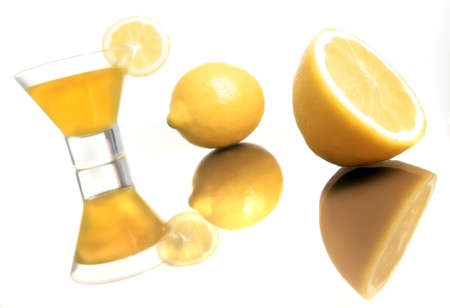 lemons with cup standing on the white Stock Photo - 2737333