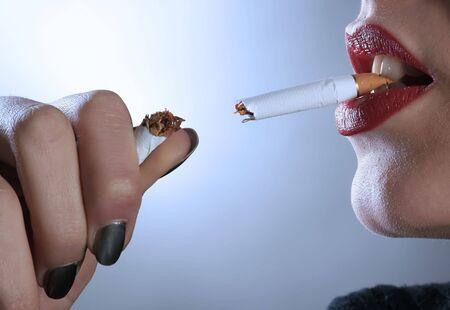 a sensual female is breaking the cigarette