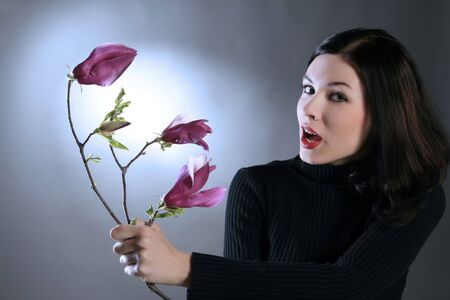a beauty girl is golding lovely pink flower Stock Photo - 2838448
