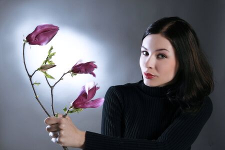 a beauty girl is golding lovely pink flower 2 Stock Photo - 2838523