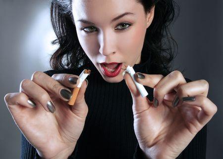 a beauty girl is breaking the cigarette