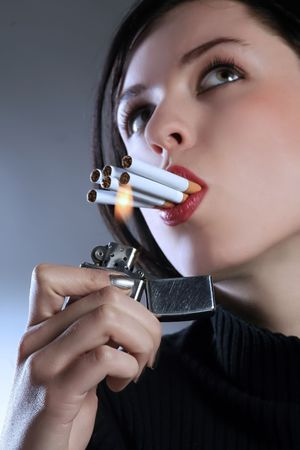 a tough lady smoker with six cigarettes Stock Photo