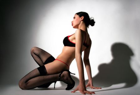 a black sensual lady in erotic lingerie
