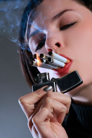 a female with six cigarettes in mouth