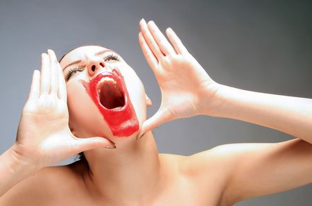 a beauty female with red lips is screaming Stock Photo