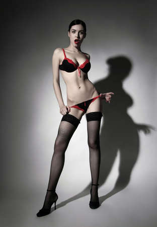 a suprised lady standing in sexy lingerie