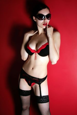 a lady in red lingerie and sunglasess