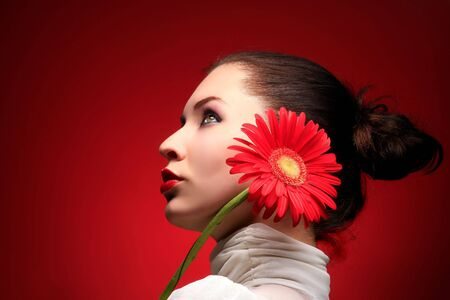 a beauty brunette with red flower looking up Stock Photo - 3055640