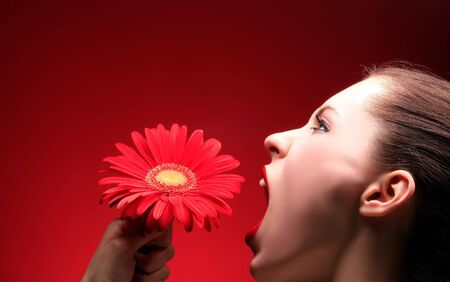 a beauty brunette is screaming at red flower Stock Photo - 3055614