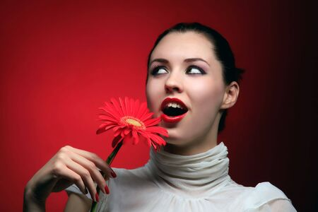 a beautiful woman in white on red Stock Photo - 3055607
