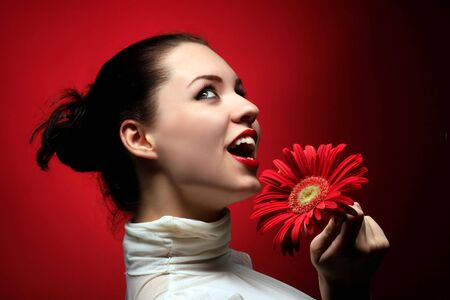 a beauty happy girl with red flower Stock Photo - 3055642