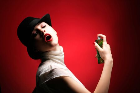 a beauty retro girl with parfum on red