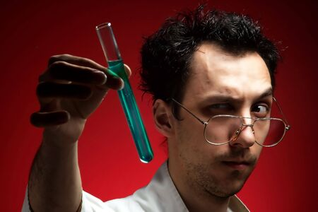 a crazy doctor with glasses on red Stock Photo