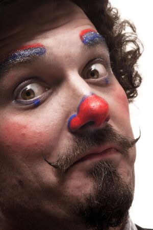 expressing: a funny portrait of a clown with red nose