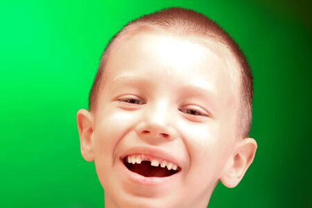 a smiling boy on the green background Stock Photo - 3124810