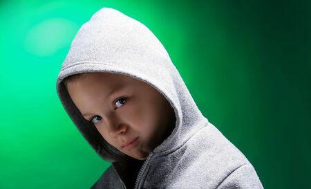 a portrait of a blond boy on green Stock Photo - 3124824