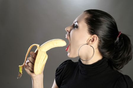 a beauty girl is eating banana Stock Photo