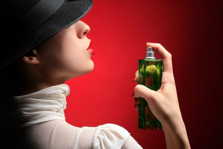 parfume: retro lady with parfume on the red Stock Photo