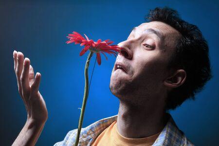 photo of a yound sad man on blue background photo