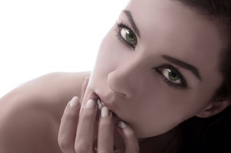 shinning light: female green eyes on the white background