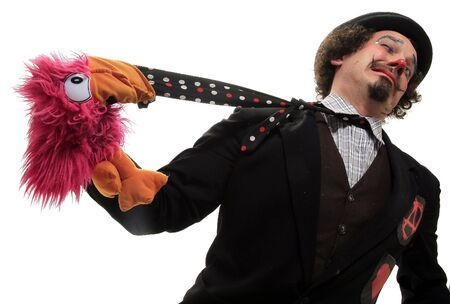 portrait of a funny clown with pink parrot Stock Photo