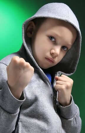 photo of a boy with grimase on green Stock Photo - 3277850