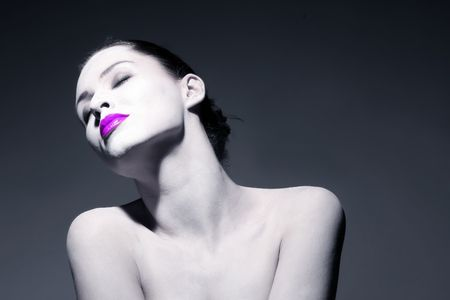 portrait of a beauty relaxd girl with violet lips