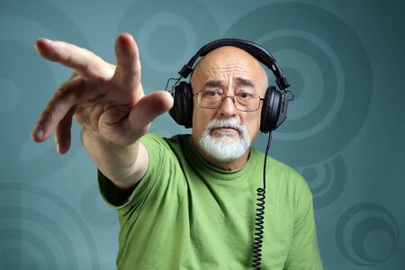 eroded: photo of an old dancing dj with headphones Stock Photo