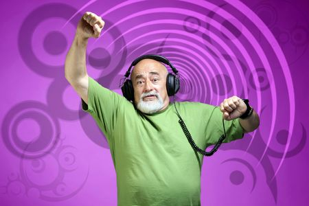 photo of an old dancing dj with headphones Stock Photo