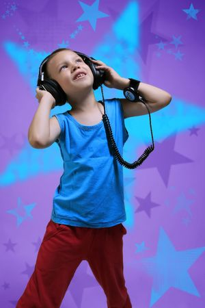 photo of an young dancing dj with headphones Stock Photo