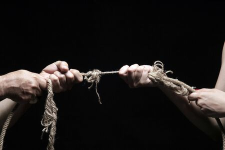 photo of a rope with hand pulling Stock Photo - 3277683