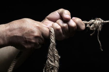 adversary: photo of a rope with hand pulling