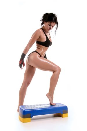 fitness girl is working out with stepper