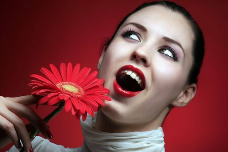 girl is smiling and holding red flower Stock Photo - 4409602