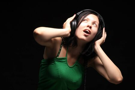 a beauty girl enjoying and listening the music