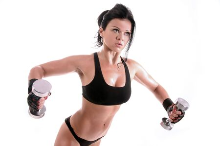 fitness girl is working out with weights Stock Photo - 4527397