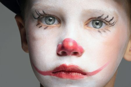 portrait of make up clown boy with red nose Stock Photo