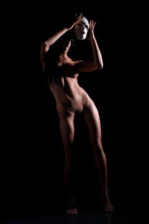 erotic fantasy: perfect females body in shadow with white mask